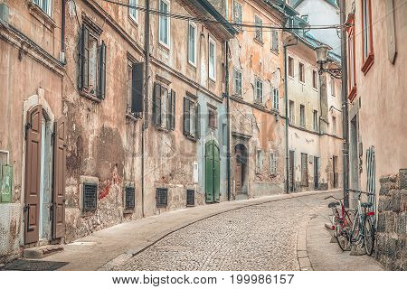 Side street with old shabby buildings yet colorful located in the old city center of Ljubljana the capital of Slovenia.