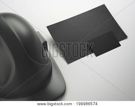 Black helmet and business card on white floor. 3d rendering
