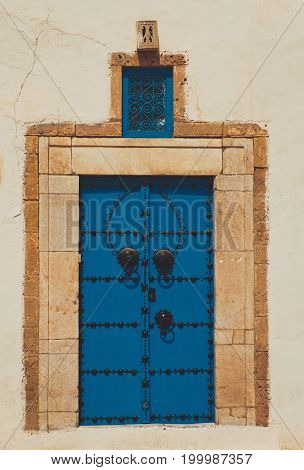 Old blue forged door in castle or temple