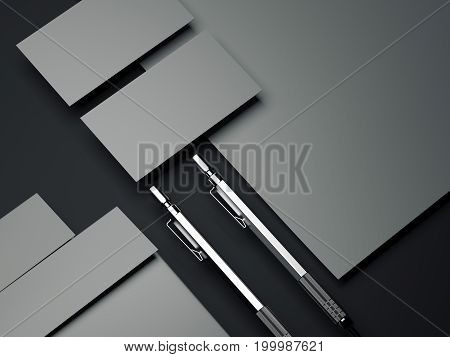 Gray branding mockup with silver pens on dark floor. 3d rendering