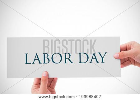 Hand showing card against labor day text