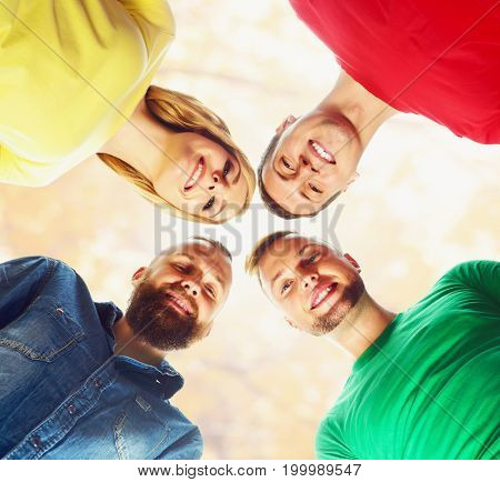 Smiling students in colorful clothing standing together.  School, education, university, study: concept.