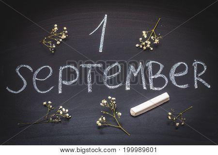 The Inscription Is September 1. Chalk On A Blackboard.