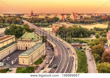 Warsaw, Poland: central part of the city and Vistula river in the sunset