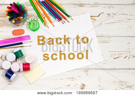 School Supplies On A White Wooden Background With An Empty Space For Inscriptions.
