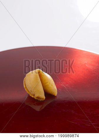 One Fortune Cookie on a Red Plate