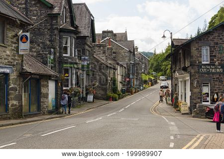 Betws y Coed Wales UK - August 15 2017: Betws-y-Coed main street with its old shops and guest houses. The village is located in the Conwy Valley and is a major outdoor sport and tourist destination