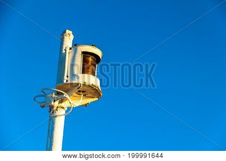 Isolated Navigation light with blue sky on the background