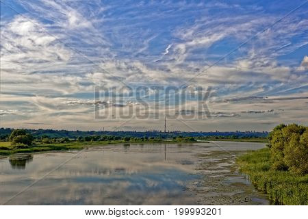 Beautiful clouds of interesting shapes hovered over the riverbank.