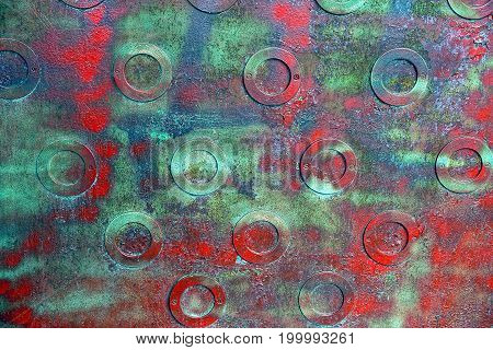 Red green iron texture of a metal wall