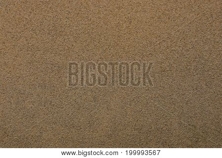 Gray brown background of a piece of concrete wall