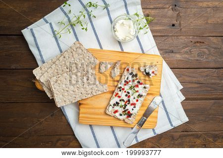 Appetizer toast with cheese red bell pepper olives and thyme. Healthy food vegan or diet nutrition concept on wooden table