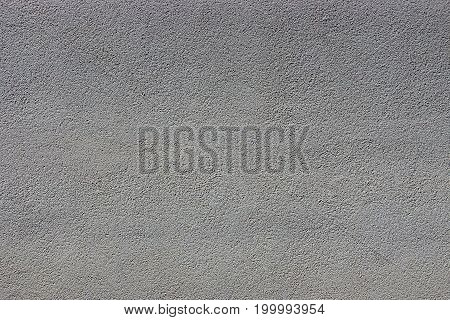 Dark gray background of a part of a concrete wall