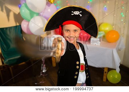 Boy pretending to be as pirate during birthday party at home