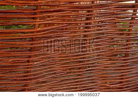 Wooden brown texture of thin rural fence rods