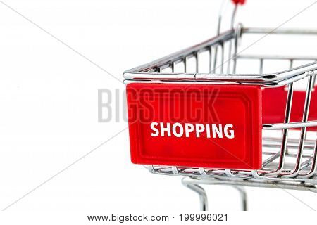 Empty shopping cart with text shopping closeup on white background