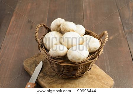 A Basket Of Champignion And Knife