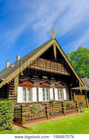 POTSDAM GERMANY - AUGUST 15; 2017: Typacal Russian wooden house in the Russian colony Alexandrowka in Potsdam Germany.