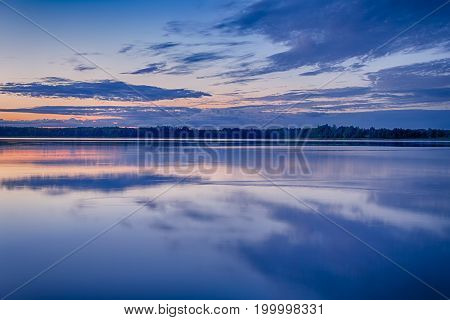 Scenic Destinations and Travel Concepts. Belarussian National Park Braslav Lakes at Sunset during Summertime. Horizontal Orientation