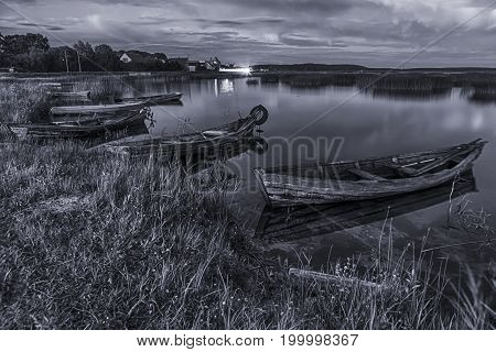 Braslav Lakes in Belarus. Two Boats Floating on Water in The Evening. Black And White Toned Image. Horizontal Shot