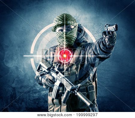 Masked terrorist man with gun and laser target on his body concept