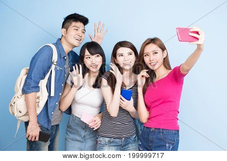 student selfie happily on the blue background