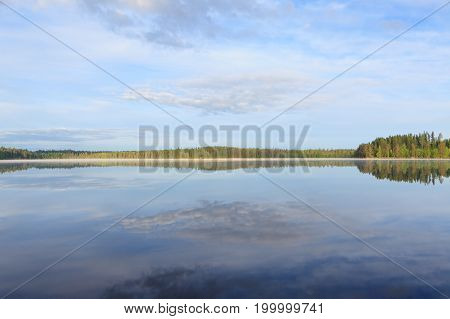 Still lake scape at summer morning in Finland