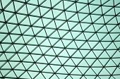 Abstract patterned glass roof forming triangles and lines poster