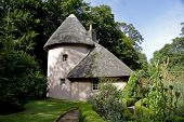 Thathched cottage in Mellerstain House in the Scottish Borders poster