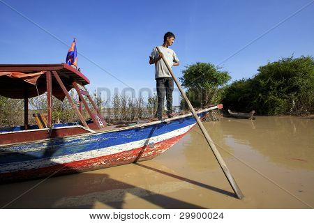 Man on boat Cambodia