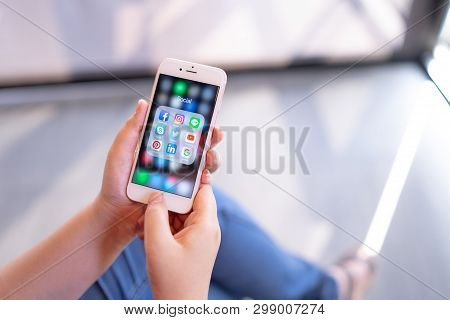 Chiang Mai, Thailand - Apr.08,2019: Woman Holding Apple Iphone 6s Rose Gold With Icons Of Social Med