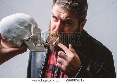 Smoking Is Harmful. Habit To Smoke Tobacco Bring Harm To Your Body. Man Smoking Cigarette Near Human