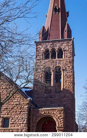 Bell Tower And Steeple Above Entrance Of Landmark Church Built In Richardsonian Romanesque Style Arc