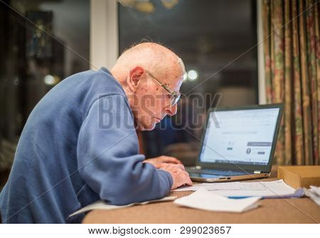 Old Man Using A Computer ,hampshire,england,u.k.