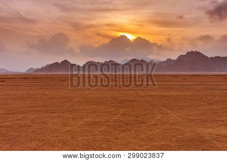 Orange Beautiful Sunset Above Mountains At Sinai Desert, Sharm El Sheikh, Sinai Peninsula, Egypt.