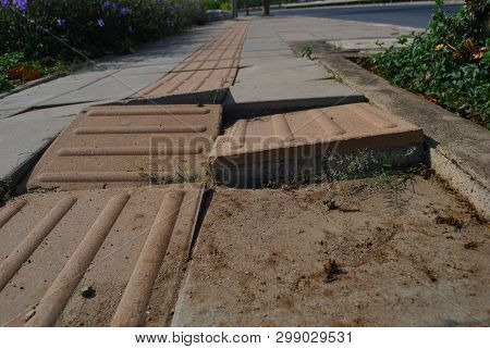 Damaged Sidewalks Are Caused By Collapsed Soil.