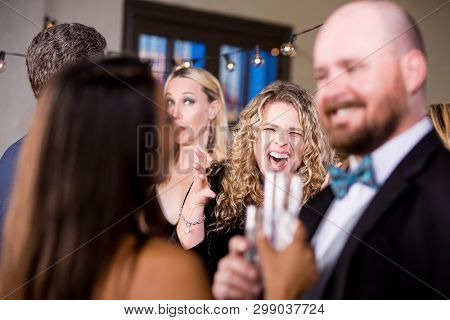 Angry Woman Screaming At A Happy Couple At Party