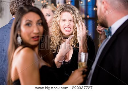 Angry Woman Screaming And Pointing To Her Wedding Ring