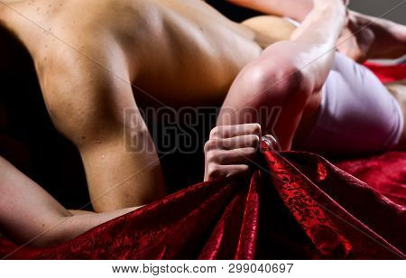 Sex And Pleasure Concept. Feeling Of Intense Sexual Pleasure. Hand Squeeze Bedclothes. Naked Lovers