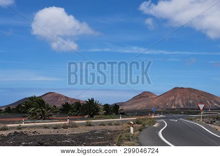 Road Near Yaiza In Lanzarote With View To The Timanfaya National Park