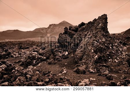 Sepia Color Photography Of The Volcanic Landscape Around Timanfaya National Park In Lanzarote