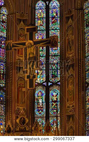 Florence/italy -  april 06, 2018: Crucifix And Stained Glass Window In Basilica Di Santa Croce