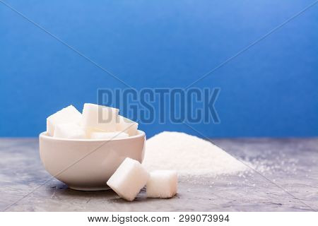 Pieces Of Refined Sugar In A Bowl And Next, A Pile Of Sugar Sand On The Table