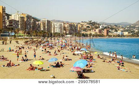 Malaga, Spain - July 27, 2018. People On Malagueta Beach, Malaga, Costa Del Sol, Malaga Province, An