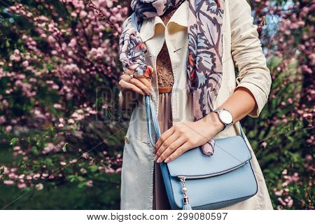 Young Woman Holding Stylish Handbag And Wearing Trendy Outfit. Spring Female Clothes And Accessories