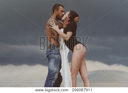Muscular Man And Young Female Kissing. Beautiful Young Couple Hugging. Love Concept. Couple Is Huggi