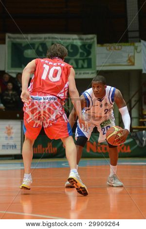 KAPOSVAR, HUNGARY - JANUARY 28: Kwadzo Ahelgebe (in white) in action at a Hungarian Championship basketball game with Kaposvar (white) vs. Nyiregyhaza (red) on January 28, 2012 in Kaposvar, Hungary.