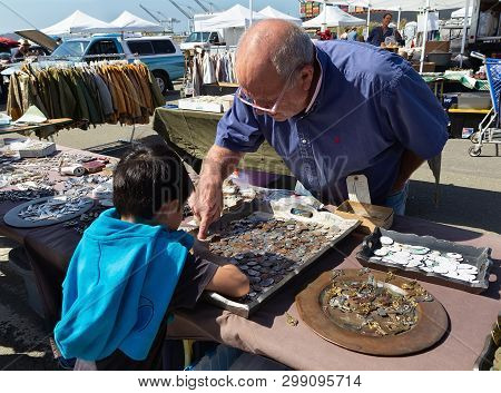 Alameda,ca/usa - September 4, 2016: Seller And Boy With Coin Charms At Flea Market.
