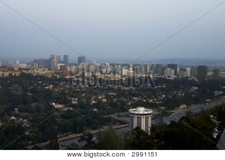 Aerial view of Los Angeles with buildings from Westwood and Century City prominent. poster