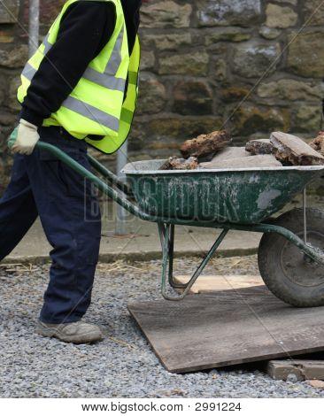 Worker And Wheelbarrow